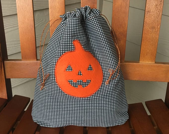 Featured listing image: Trick-or-treat drawstring gift bag with a felt jack o' lantern pumpkin appliqué for Halloween bag or gift, reusable gift bags, 10 x 12.5