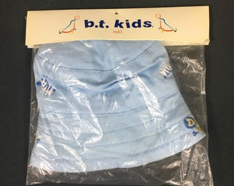 Blue baby sailor style sun or beach hat with yellow lining and embroidered zoo animals by B.T. Kids from 1990's new in package, small size