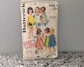 Girl's smock and bloomers pattern, vintage Butterick 2651 size 6 from 1960's, yoked or shallow neck with back buttons, flower shape pocket