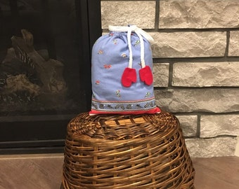 Hanukkah or Christmas fabric gift bag with drawstring made of flannel with hats mittens and ice skates print, 8 x 11
