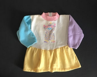 Clown print pink and blue color block sleeves vintage baby girl top or tunic dress size 24 M 2T Buster Brown brand from the 1980's
