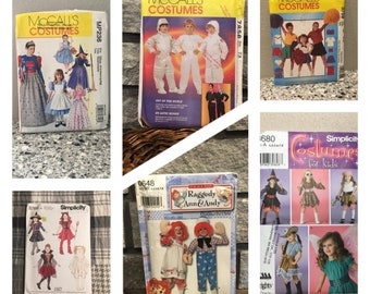 Kid's costume sewing patterns for fairy, witch, devil, queen, cowgirl, pirate, hippie, mummy, Raggedy Ann, Dorothy, Cheerleader, Astronaut