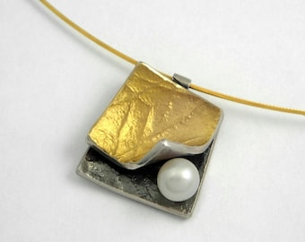 There are pearls between the pages of a book! An alternative and modern design, rough surface, stylish gold silver pendant with a pearl.