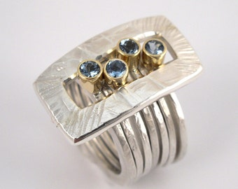 Stacking 7 in 1, hammered gold and silver modern ring with aquamarine precious stones.