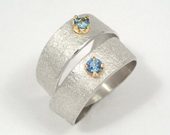 Two band ring made of argentium silver and two aquamarines gemstones, A couple's statement ring, Wide band ring, Aquamarine wrap ring.