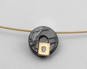Minimal oxidized silver and gold circular charm necklace with diamond and textured surface, Black gold necklace, Geometric charm.