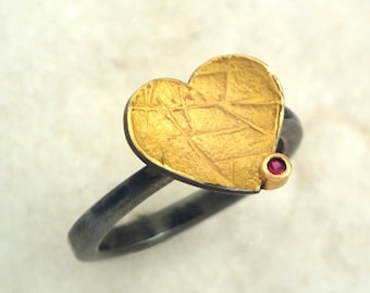 A modern gold oxidized silver heart ring with a genuine ruby and hammered band, Two tone ring, Small ruby ring, Textured ring, Gift for her.