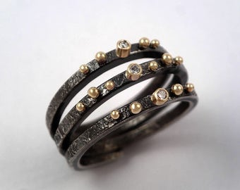 Gold water drops on a bryony tendril. An artistic modern gold and oxidized silver ring with diamonds and studded gold granules,Spiral ring