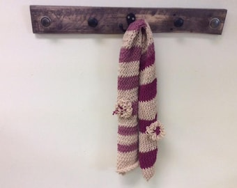 Scarves of many colors: 2 shades of purple and beige.