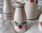 The Crock Shop, Santa Ana, California pottery milk bottle vase with apples and ivy pattern. Pretty vintage red apple and green ivy milk jug