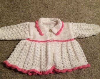 Hand knitted baby matinee coat