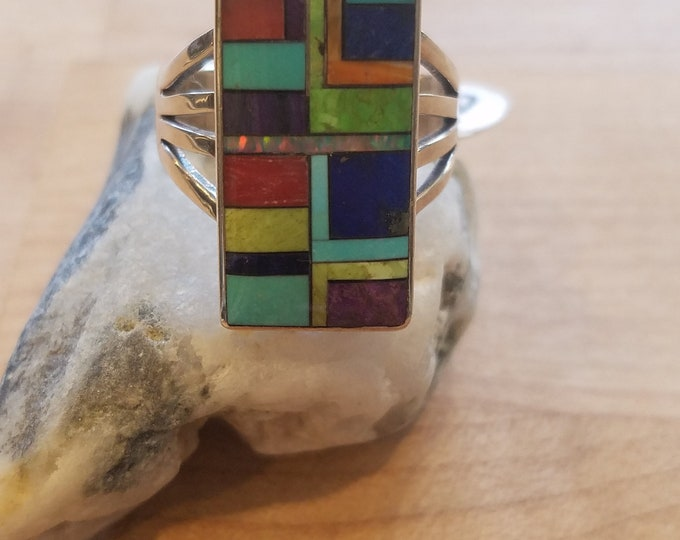 Yes! Size 9.5 multi-stone ring set in Sterling . Opal. Turquiose. Lapis. Onyx. Agate. Red Coral.