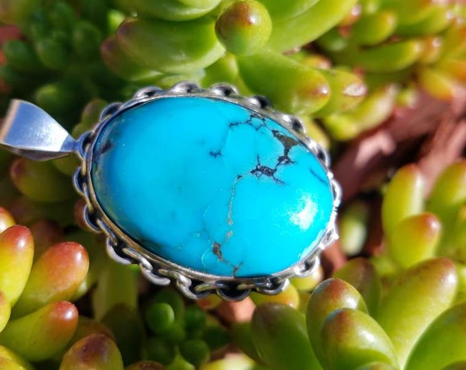 Large Turquoise and Sterling Silver Pendant . Chain like details all around stone.
