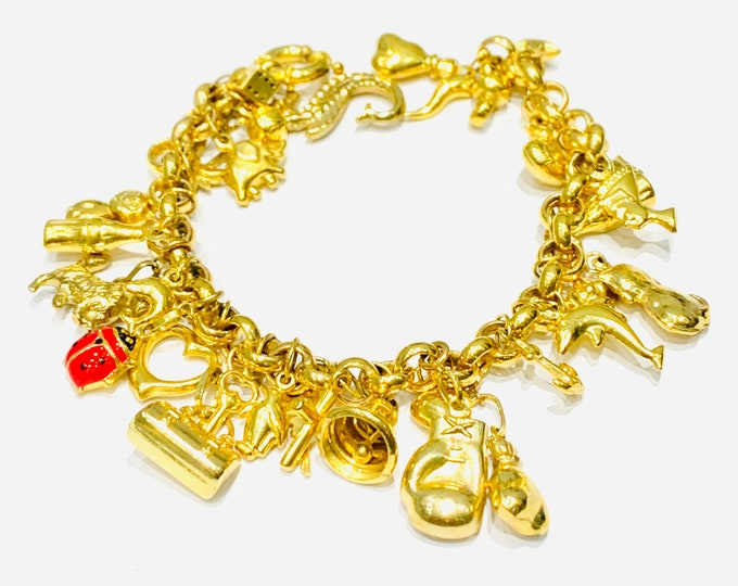 Superb vintage 9ct yellow gold 7 1/2 inch charm bracelet with 30 charms - fully hallmarked - 22gms