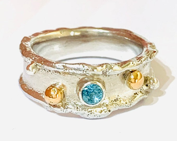 Stunning handmade sterling silver, 9ct gold and Blue Topaz - size O or US 7. Made in Sheffield