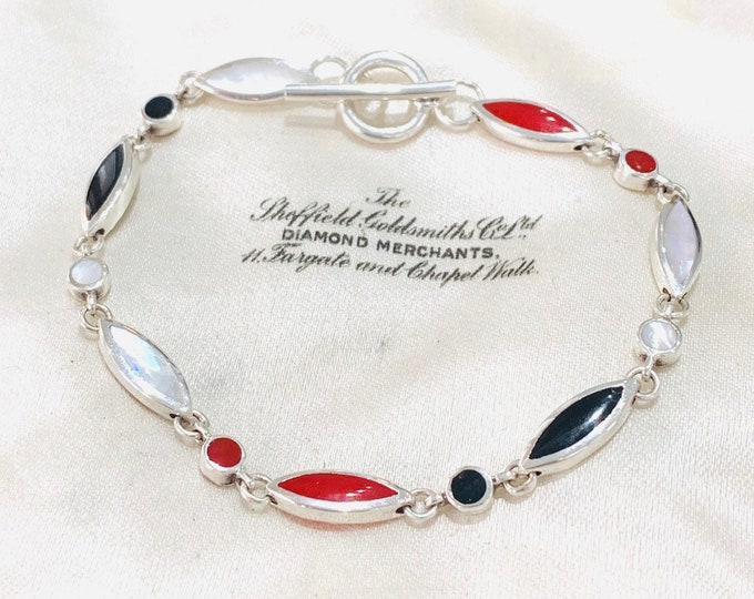Pretty vintage sterling silver 7 inch gemstone bracelet with Onyx, Mother of Pearl and Carnelian