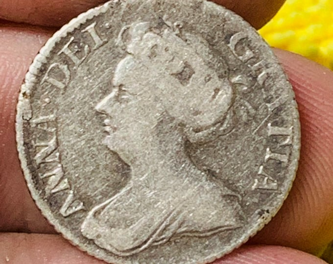 Rare silver Queen Anne Shilling dated 1711