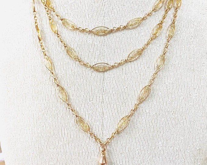 Stunning antique 9ct rose gold 56 inch Muff chain with dog clip pendant