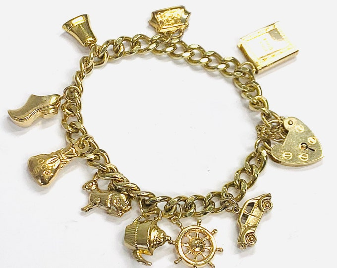 Superb vintage 9ct yellow gold 7 inch charm bracelet with 9 gold charms - fully hallmarked London 1978