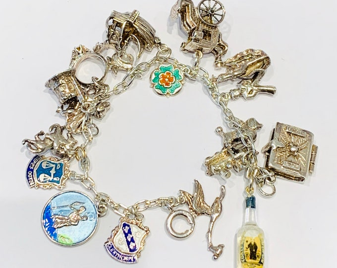 Vintage sterling silver 6 1/2 inch charm bracelet with 18 charms