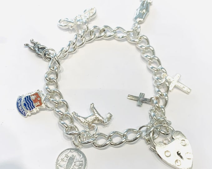 Vintage sterling silver charm bracelet with 8 charms - 7 1/2 inches in length