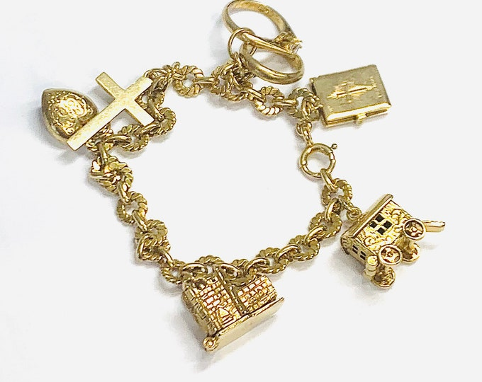 Vintage 9ct yellow gold 6 1/2 inch charm bracelet with 6 gold charms