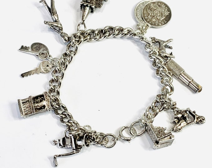 Superb vintage sterling silver charm bracelet with 11 charms - fully hallmarked - 50gms