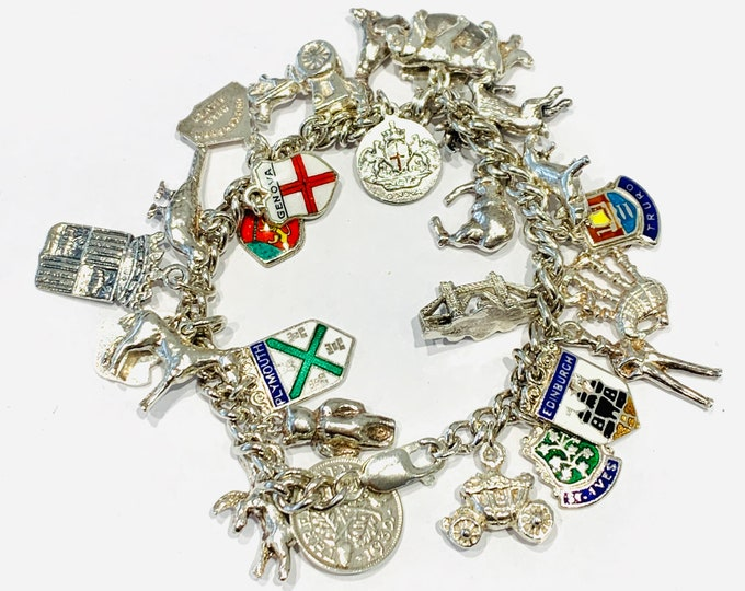 Superb vintage sterling silver 7 inch Charm Bracelet with 26 charms