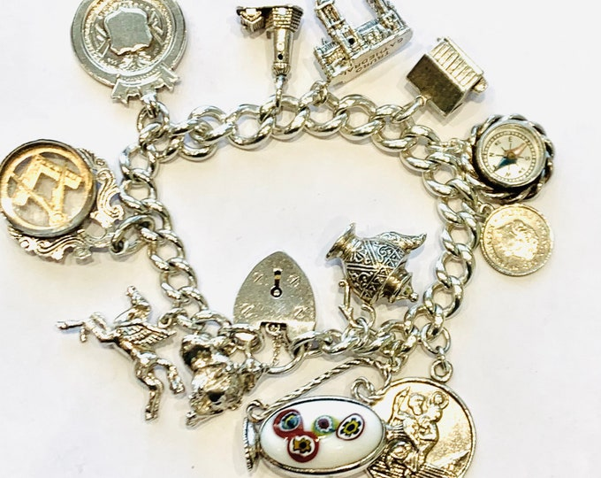 Superb heavy vintage 7 1/2 inch sterling silver charm bracelet with 12 vintage / antique charms & fobs - 88gms