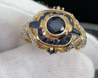 Beautiful natural Sapphire with diamond accents all in 14k.