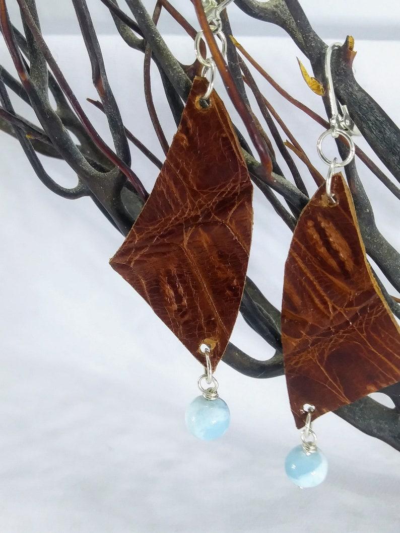 Beautiful leather earrings adorned with genuine Larimar gemstone