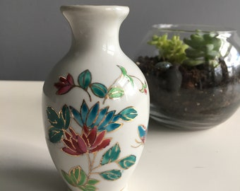 Vintage porcelain bud vase with blue and pink flowers and butterfly