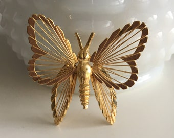 Vintage gold tone Monet butterfly brooch / pin