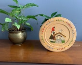 Vintage wooden hand painted plate from Bulgaria farm scene woman with pitcher and bird vibrant colors