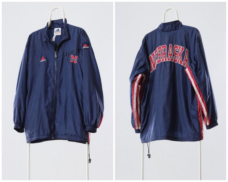 b9dd708b99917 90'S Vintage Mens ADIDAS NEBRASKA Windbreaker Tracksuit Jacket Coat Blue  Size XL