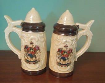 Vintage salt and pepper stein shakers. Japan