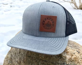 Parks Supply Trucker Hat with hand made leather patch
