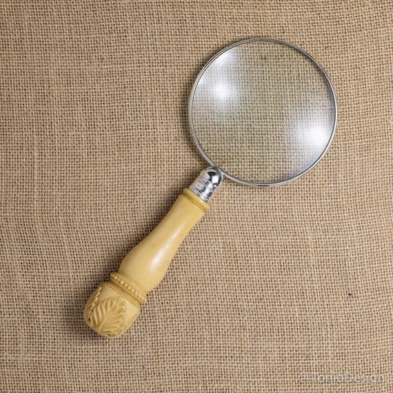 Sterling Silver Rim Magnifying Glass with a Carved Handle