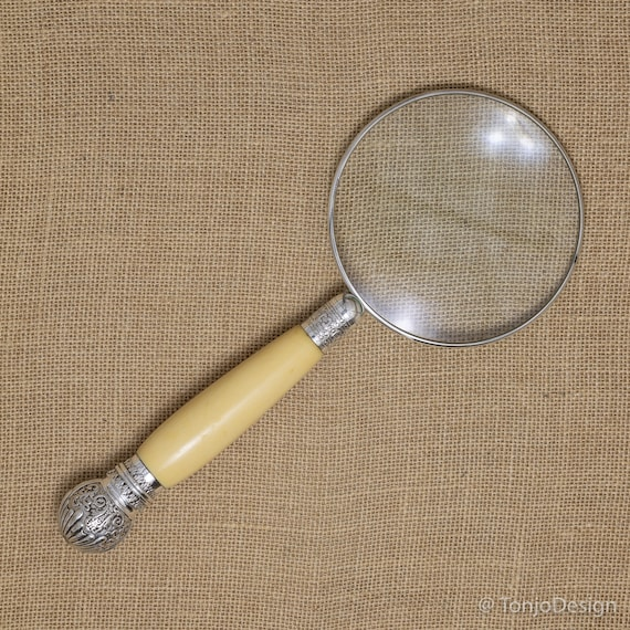 Large Magnifying Glass with a Sterling Silver Rim & Carved Handle