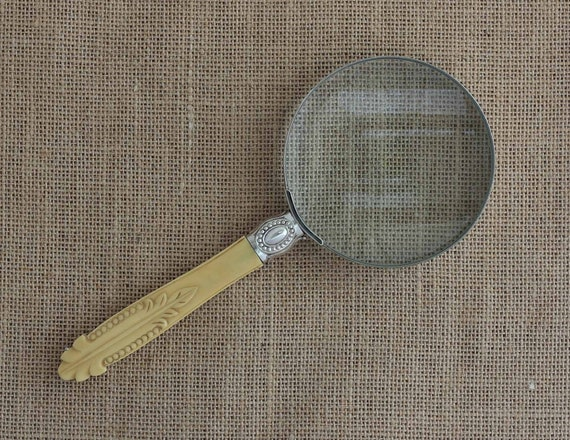 Carved Handle Chrome Rim Magnifying Glass
