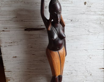 "Tribal Carving of an African Woman. This carving stands 25"". It is a hard wood. Very nicely done."