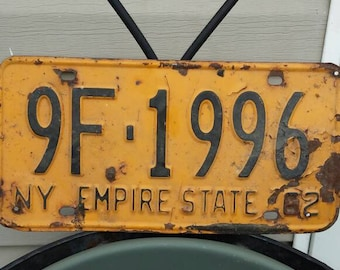 Vintage 1962 New York State  License Plate. Black numbers with yellow background. Nicely used Condition. Plate No. 9F-1996.Nice Collectible