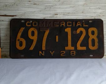 Vintage 1928 New York State Commercial License Plate. Black with Yellow Numbers. Nice Condition. Plate No. 697-128. Nice Collectible.