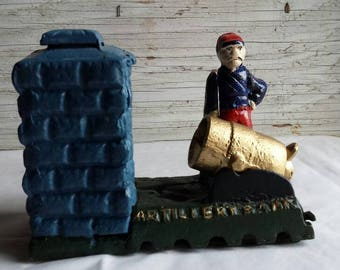 Vintage Artillery Mechanical Bank.  A Repro but Very Nice. This would make a nice Gift. In Working Condition.  Very clean. Nice Colors.