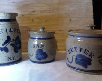 Vintage 1986 set of 3 Stoneware Kitchen Pieces.  Includes jam jar with lid, butter dish with lid and utensil holder. All artist signed.