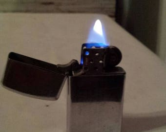 Vintage 1970 Zippo Slimline Lighter. Nice Brushed Chrome Design with Lines. Nicely used Working Condition. Free Shipping USA. Spot 2 engrave