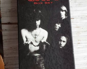 Classic 60s and 70s Rock Group the Doors. 4 CD Box Set from 1997. Morrison, Kreiger, Manzarek and Densmore are great. Gently Used Condition.