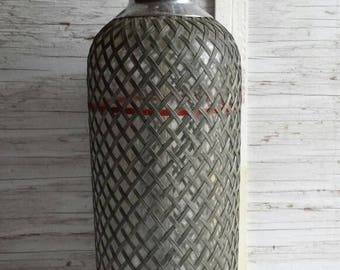 Vintage 1920s  Sparklets Corp Seltzer Bottle. Pewter Wrapped Mesh around this Bottle Made in Czechoslovakia.  32 oz. Cap. 13 inches tall.