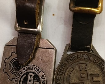 2 Vintage Advertising Watch FOBs from L.B. Smith Inc.