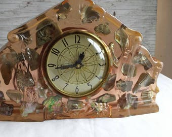 Vintage 1950s Lucite Mantel/Shelf Electric Clock with Lanshire Movement. Very Nice Working Condition. Sea Shells Encased in Lucite. 10x7x2.